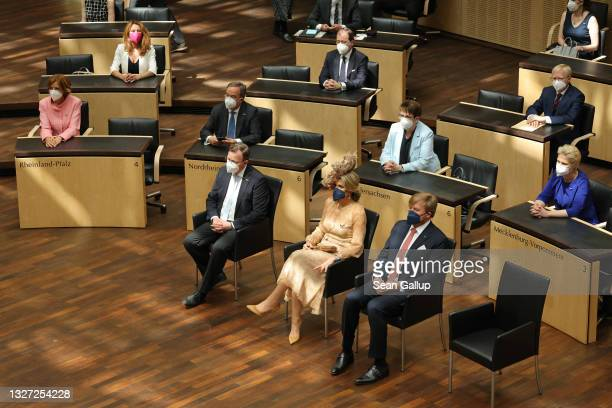 King Willem-Alexander and Queen Maxima of the Netherlands sit next to Bundesrat President Reiner Haseloff as they attend a session of the Bundesrat...