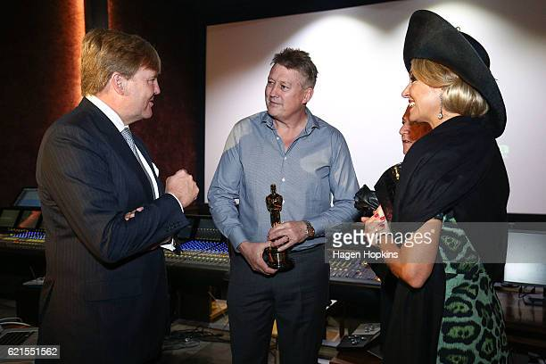 King WillemAlexander and Queen Maxima of the Netherlands speak to Oscar winners Michael Hedges and Joe Letteri during a visit to Park Road Post on...