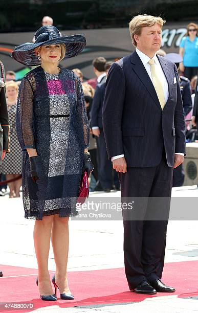 King WillemAlexander and Queen Maxima of The Netherlands stand at the National War Memorial prior to laying a wreath during a during a state visit to...