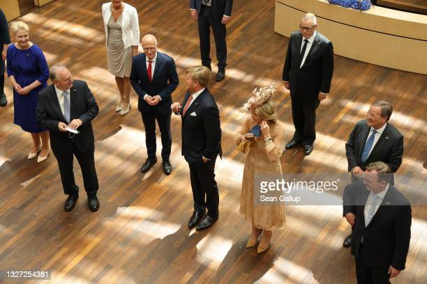 King Willem-Alexander and Queen Maxima of the Netherlands stand with the heads of Germany's 16 states at a session of the Bundesrat in their honour...