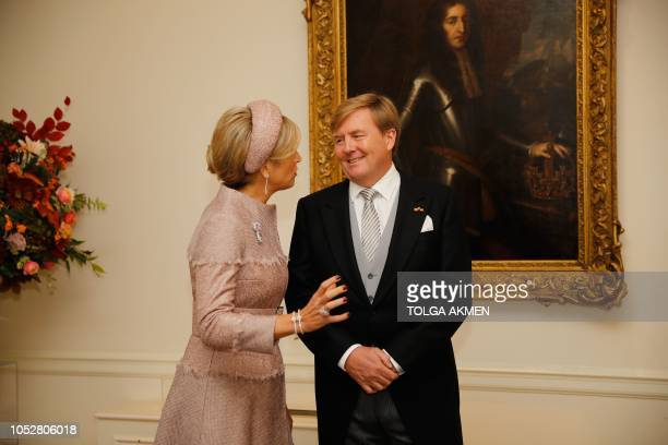 King WillemAlexander and Queen Maxima of the Netherlands wait to be greeted by Britain's Prince Charles Prince of Wales and Britain's Camilla Duchess...