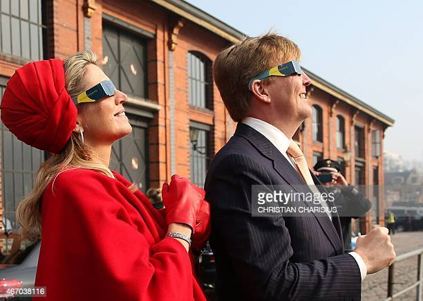 King WillemAlexander and Queen Maxima of The Netherlands watch a partial solar eclipse on March 20 2015 in Hamburg The Dutch King and Queen are in...