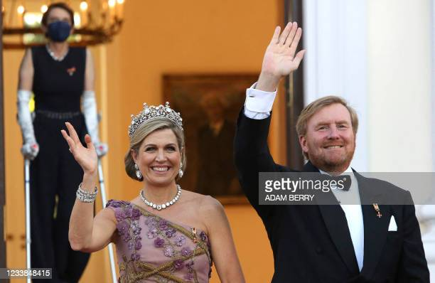 King Willem-Alexander and Queen Maxima of the Netherlands wave as they arrive for a state dinner in their honour at the Bellevue presidential palace...