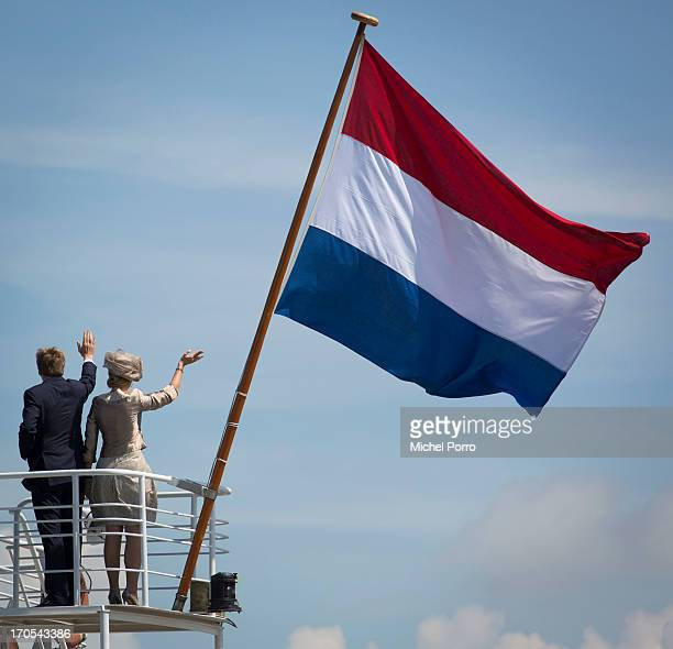 King WillemAlexander and Queen Maxima of the Netherlands wave from a boat during an official visit to Stavoren on June 14 2013 in Stavoren Netherlands