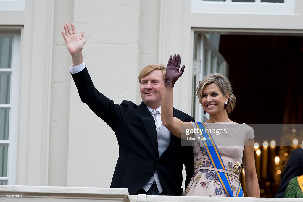 King Willem-Alexander and Queen Maxima of The Netherlands wave from the balcony of The Noordeinde Palace during Prinsjesdag (Prince's Day) on September 15, 2015 in The Hague, Netherland.
