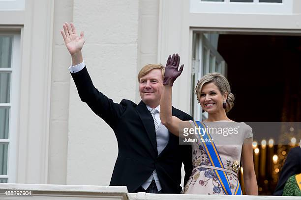 King WillemAlexander and Queen Maxima of The Netherlands wave from the balcony of The Noordeinde Palace during Prinsjesdag on September 15 2015 in...