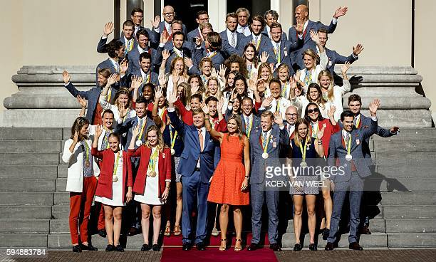 King Willem-Alexander and Queen Maxima pose with Olympic medal winners at the Palace Noordeinde on August 24, 2016 in The Hague. / AFP / ANP / Koen...