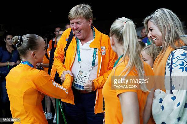 TOPSHOT King WillemAlexander and Queen Maxima R0 congratulate Netherlands' Sanne Wevers on winning the women's balance beam event final of the...