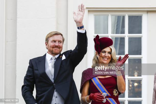 King Willem-Alexander and Queen Maxima wave to bystanders from the balcony at Noordeinde Palace in The Hague on September 17, 2019 on the Prinsjesdag...
