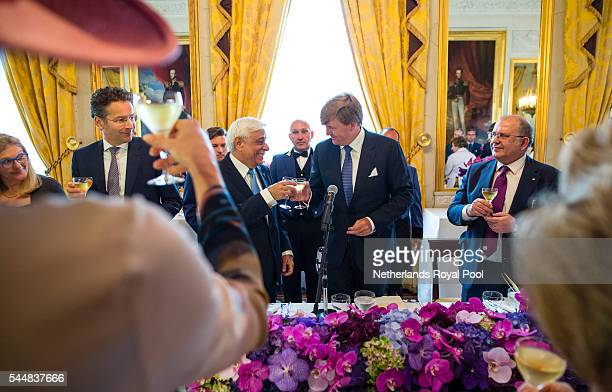 King WillemAlexander and visiting Greek President Prokopis Pavlopoulos toast during a lunch at the Noordeinde Palace at the start of a twoday visit...
