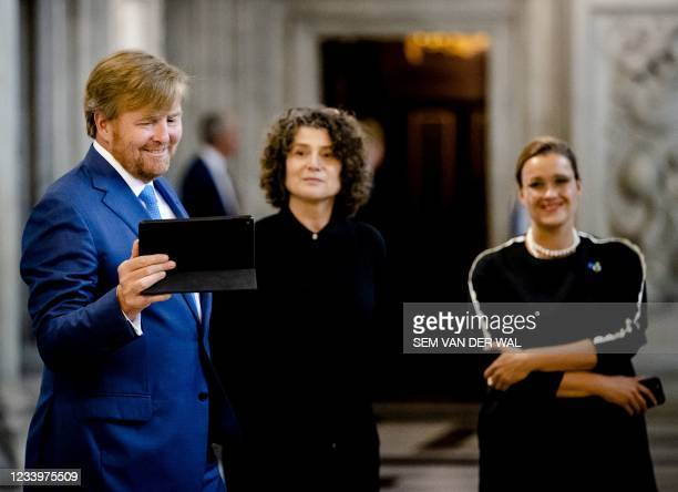 King Willem-Alexander attends the presentation of the Royal Prize for Free Painting 2021, in the Royal Palace, in Amsterdam, on July 14 as he is...