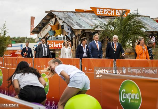 King Willem-Alexander is given a tour during the opening of TeamNL Olympic Festival on the sports beach in The Hague. The three-week festival is...