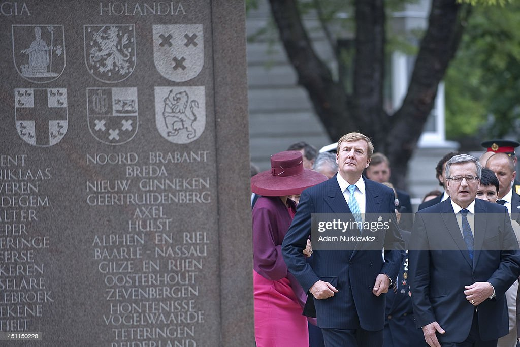 King Willem-Alexander of the Netherands and Bronislaw Komorowski President of Poland visit the monument of Polish World War II veteran General Stanislav Maczek as part of his trip to Poland on June 24, 2014 in Warsaw, Poland.