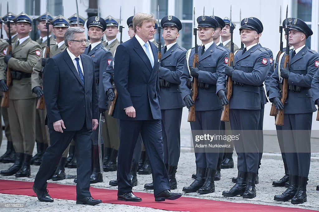 King Willem-Alexander of the Netherlands and Bronislaw Komorowski (L) President of Poland review an honour guard at Presidential Palace on June 24, 2014 in Warsaw, Poland.