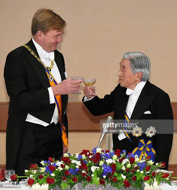 King WillemAlexander of the Netherlands and Emperor Akihito toast during the state dinner at the Imperial Palace on October 29 2014 in Tokyo Japan...