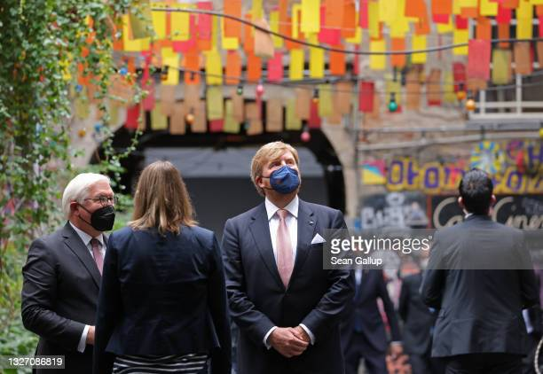 King Willem-Alexander of the Netherlands and German President Frank-Walter Steinmeier arrive to visit the Anne Frank Center on July 05, 2021 in...