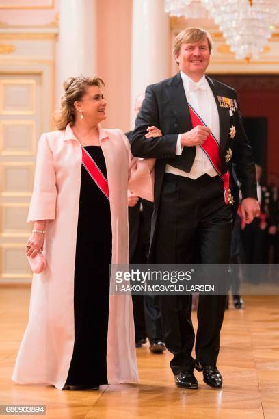 King WillemAlexander of the Netherlands and grand duchess MariaTeresa of Luxembourg arrive for a gala dinner at the Royal Palace in Oslo Norway on...