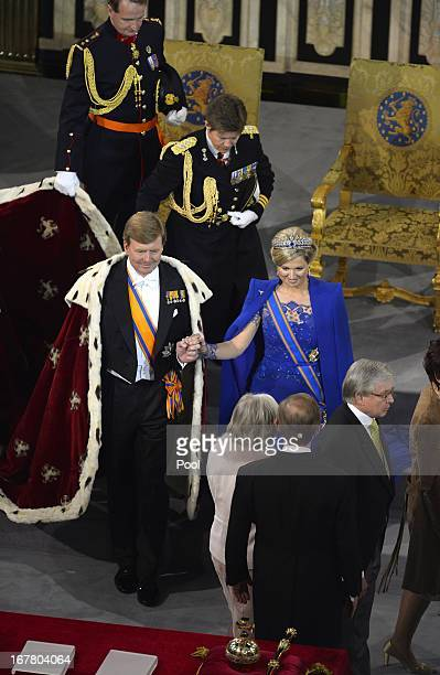 King WillemAlexander of the Netherlands and his wife Queen Maxima of the Netherlands leave after King WillemAlexander's inauguration ceremony at...