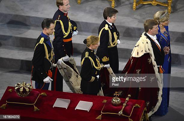 King WillemAlexander of the Netherlands and his wife Queen Maxima of the Netherlands leave after his inauguration ceremony at New Church on April 30...