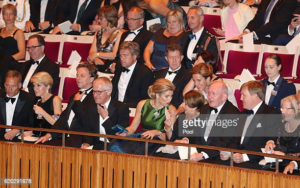 King WillemAlexander of the Netherlands and his wife Queen Maxima sit next to Australian Prime Minister Malcolm Turnbull and his wife Lucy and...