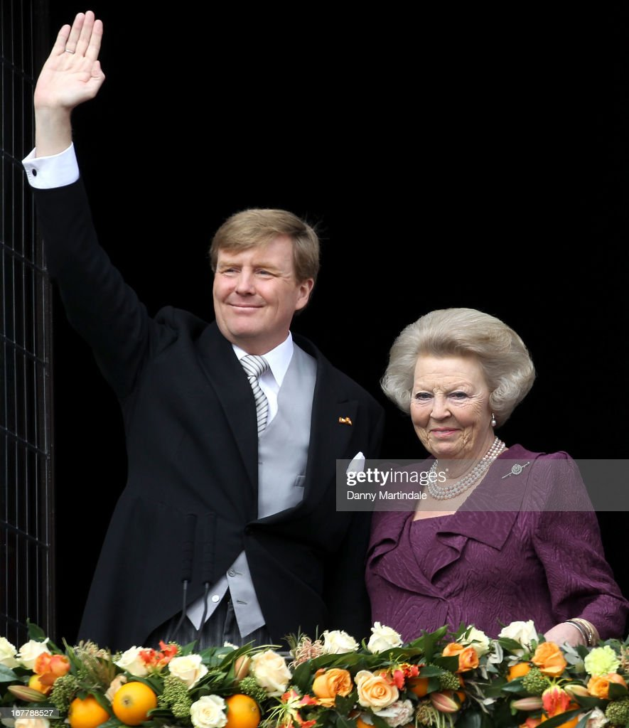 HM King Willem-Alexander of the Netherlands and HRH Princess Beatrix Of The Netherlands appear on the balcony of The Royal Palace after the abdication of Queen Beatrix of The Netherlands and ahead of the Inauguration of King Willem Alexander of The Netherlands on April 30, 2013 in Amsterdam, Netherlands.