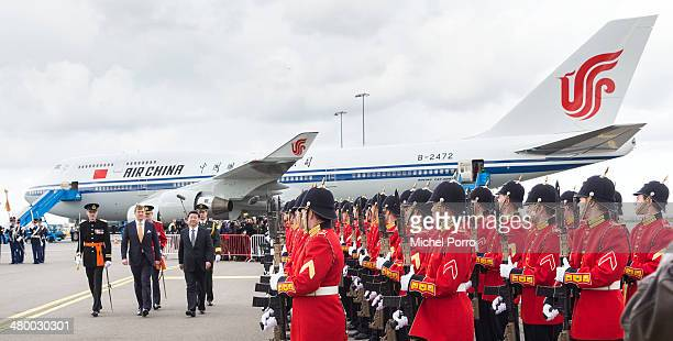 King Willem-Alexander of The Netherlands and President Xi Jinping of China review the honour guards upon Xi's arrival at Schiphol International...