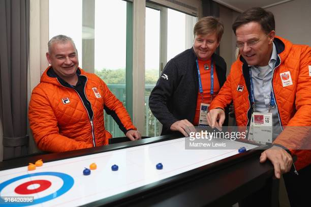 King Willem-Alexander of the Netherlands and Prime Minister Mark Rutte visit the Gangneung Athletes Village on February 10, 2018 in Pyeongchang-gun,...