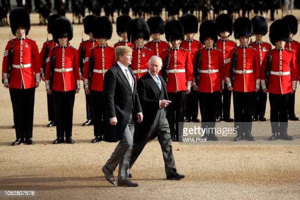 King WillemAlexander of the Netherlands and Prince Charles Prince of Wales inspect an honour guard during a Ceremonial Welcome on Horse Guards Parade...
