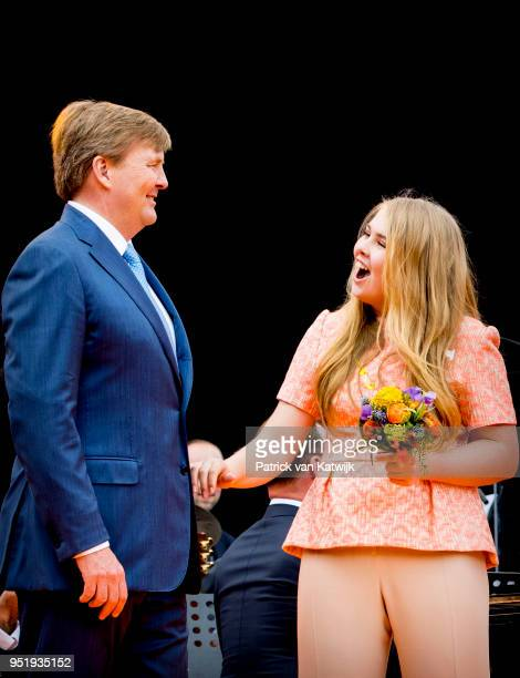 King WillemAlexander of The Netherlands and Princess Amalia of The Netherlands attend the Kingsday celebration on April 27 2018 in Groningen...