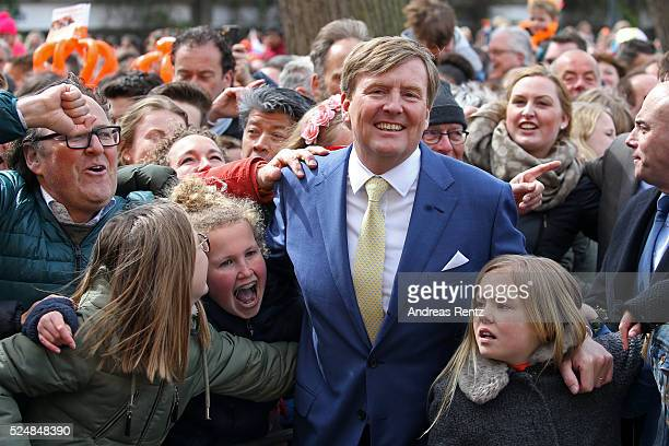 King Willem-Alexander of The Netherlands and Princess Ariane of The Netherlands dance with spectators during King's Day , the celebration of the...