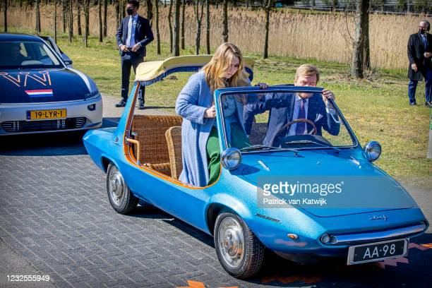 King Willem-Alexander of The Netherlands and Princess Catharina-Amalia climb into a car during the Kingsday Celebration on April 27, 2021 in...