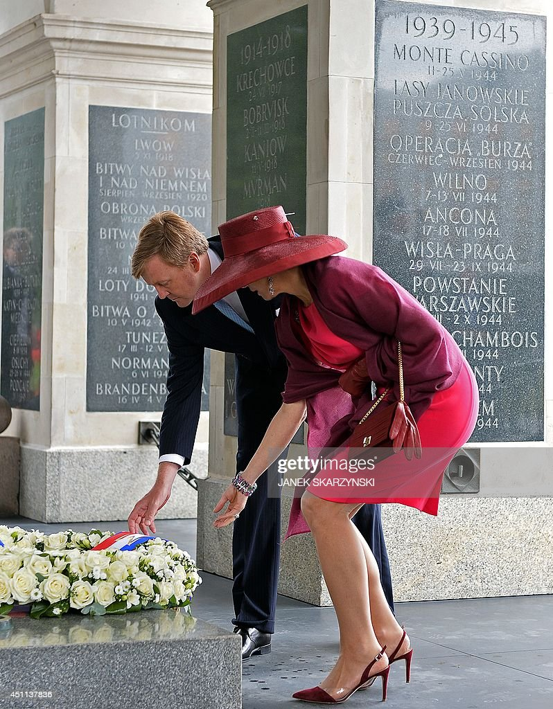 King Willem-Alexander of the Netherlands and Queen Maxima attend the wreath laying ceremony at the Tomb of the Unknown Soldier on June 24, 2014 in Warsaw.