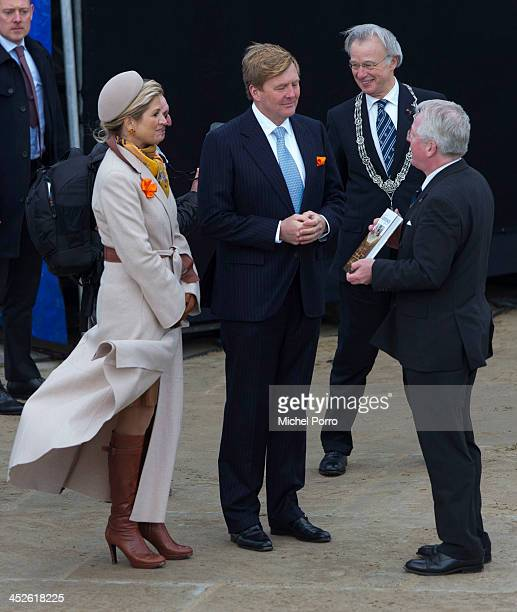 King WillemAlexander of The Netherlands and Queen Maxima of The Netherlands receive a book about Scheveningen from Hen Grootveld during the 200th...