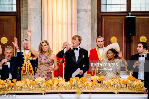 King WillemAlexander of the Netherlands and Queen Maxima of The Netherlands raise a toast at a dinner for 150 Dutch people to celebrate the king's...