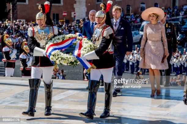 King Willem-Alexander of The Netherlands and Queen Maxima of The Netherlands attend a commemoration ceremony and lay down a wreath at the Altare...