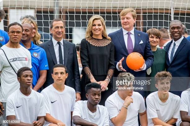 King Willem-Alexander of The Netherlands and Queen Maxima of The Netherlands attend a soccer clinic with dutch former players Clarence Seedor, Aaron...