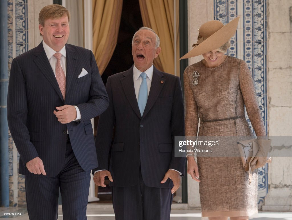 King Willem-Alexander of The Netherlands (L) and Queen Maxima of The Netherlands (R) share a laugh with Portuguese President Marcelo Rebelo de Sousa (C) in a terrace of the presidential Belem Palace on October 10, 2017 in Lisboa CDP, Portugal. Dutch Royals are on a three-days state visit to Portugal.