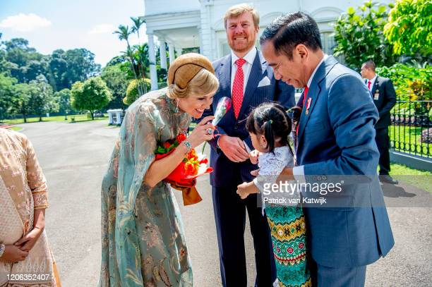 King WillemAlexander of The Netherlands and Queen Maxima of The Netherlands are welcomed by President Jcand his wife Iriana Widodo with an official...