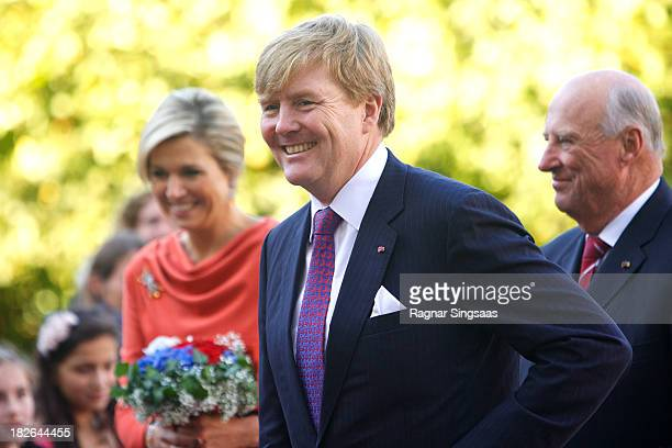 King WillemAlexander of The Netherlands and Queen Maxima Of The Netherlands accompanied by King Harald V of Norway are greeted by wellwishers as they...