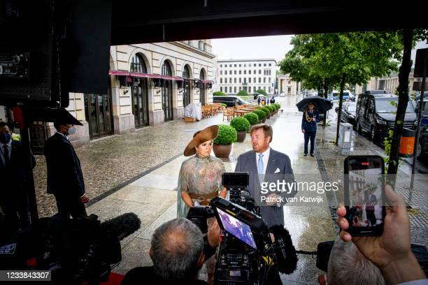 King Willem-Alexander of The Netherlands and Queen Maxima of the Netherlands give a statement outside their hotel on the shooting attack on Dutch...