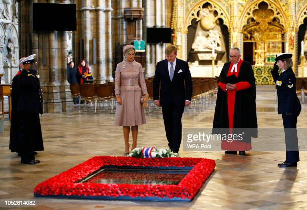 King WillemAlexander of The Netherlands and Queen Maxima of The Netherlands lay a wreath at the Tomb of the Unknown Warrior with John Hall Dean of...