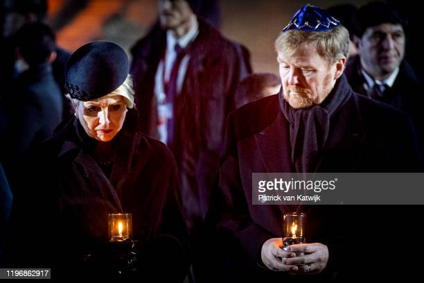 King Willem-Alexander of The Netherlands and Queen Maxima of The Netherlands lay down candles on the Auschwitz monument to commemorate the 75th...