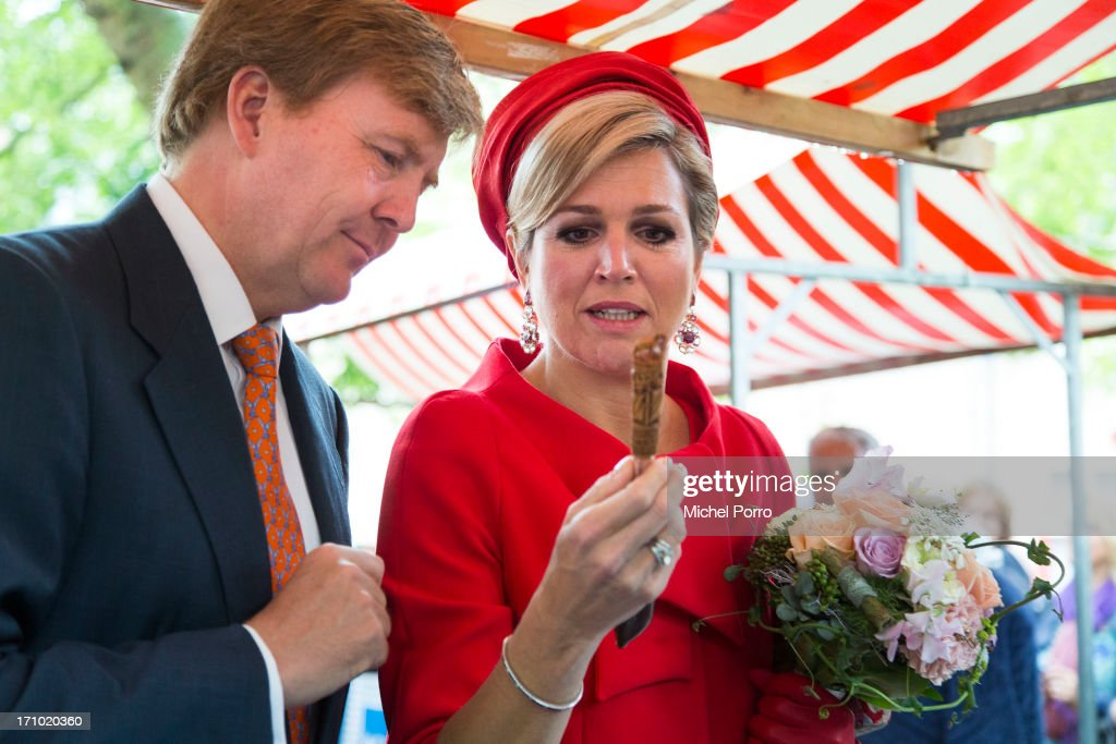 King Willem-Alexander of The Netherlands and Queen Maxima of The Netherlands look at a knife which is used to open mussels and which takes 100 hours to make during an official visit on June 21, 2013 in Middelburg, Netherlands.