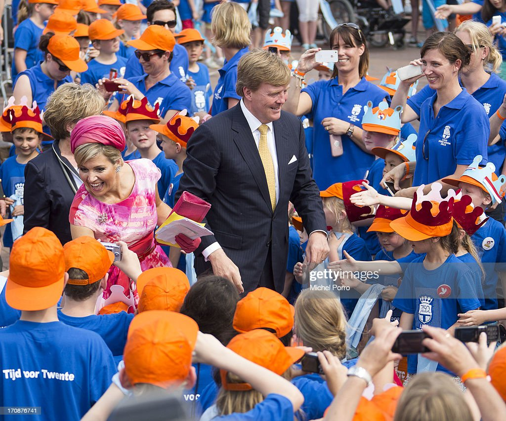 King Willem-Alexander of The Netherlands and Queen Maxima of The Netherlands make an official visit to the town centre on June 19, 2013 in Goor, Netherlands.