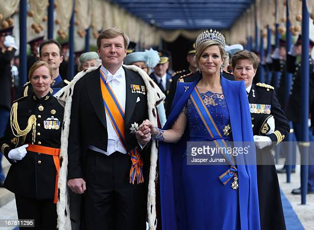 King Willem-Alexander of the Netherlands and Queen Maxima of the Netherlands leave after the inauguration ceremony of King Willem Alexander of the...