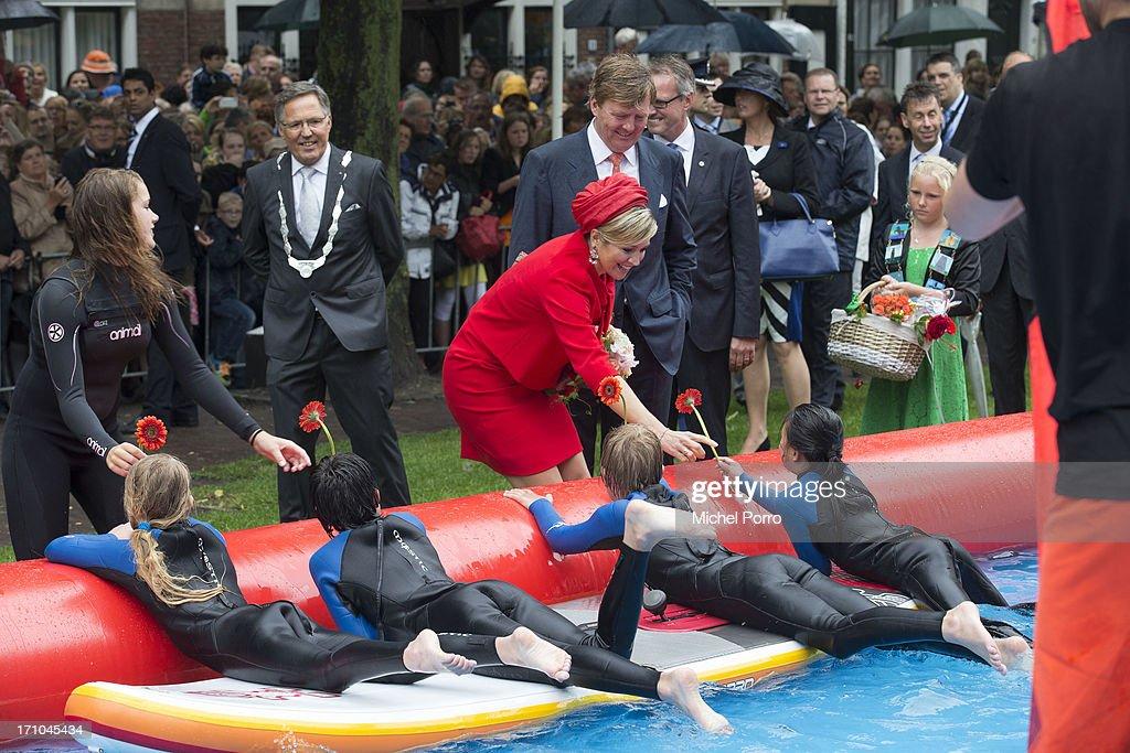 King Willem-Alexander of The Netherlands and Queen Maxima of The Netherlands watch watersport activities in Zierikzee on June 21, 2013 in Middelburg, Netherlands.