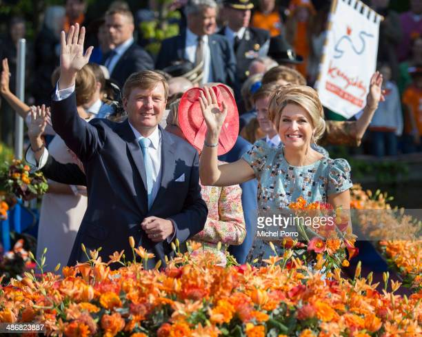 King Willem-Alexander of The Netherlands and Queen Maxima of The Netherlands celebrate King's Day on April 26, 2014 in De Rijp, Netherlands.