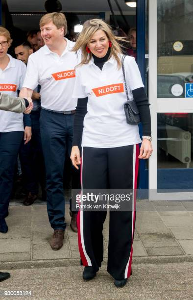King Willemalexander of The Netherlands and Queen Maxima of The Netherlands leave after volunteering during the NL Doet at residential care centre 't...