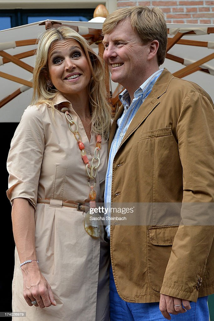 King Willem-Alexander of the Netherlands and Queen Maxima of the Netherlands pose during the annual summer photocall at Horsten Estate on July 19, 2013 in Wassenaar, Netherlands.