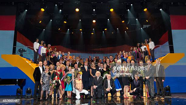 King Willem-Alexander of The Netherlands and Queen Maxima of The Netherlands pose with performers at the Circus Theatre for celebrations marking the...